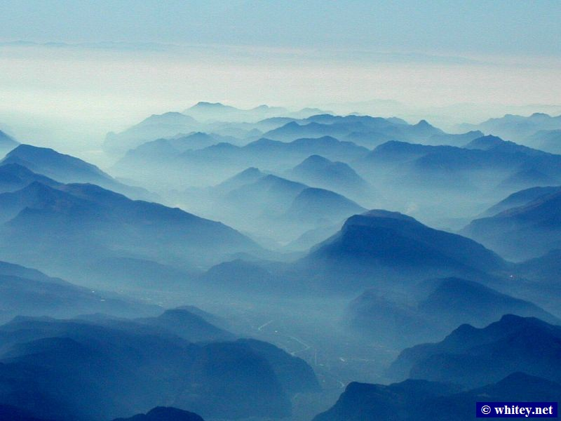 Aerial photo of the Alps covered in fog.