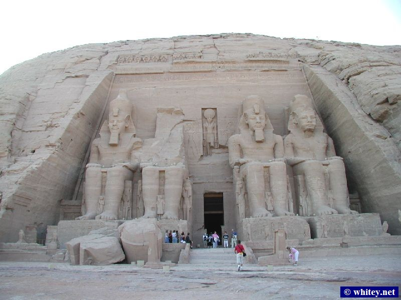 The Great Temple (the funerary complex of Ramses/Rameses/Ramesses II), Абу-Симбел, Nubian desert, Southern Египет, 1250's B.C. Twice a year, in late March and September (the vernal and autumnal equinoxes resp.), a ray of sunlight penetrates the 65 metres between the entrance and the shrines and bathes Amon-Ra and Ramses/Rameses/Ramesses II in light.   أبو سمبل