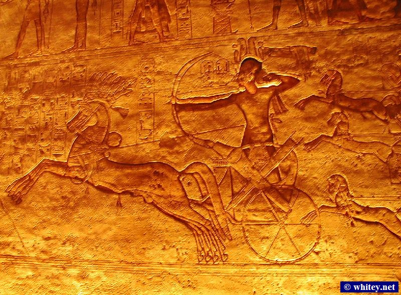 Relief of Pharaon Ramses/Rameses/Ramesses on a Chariot, Inside the Great Temple, Abou Simbel, Égypte. Multiple horse legs and bows signify movement.
