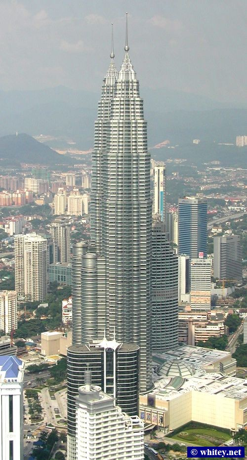 View of the Petronas Twin Towers from Menara Kuala Lumpur, Malaysia. At 451.9m tall, they were the world's tallest buildings from 1998 to 2004.