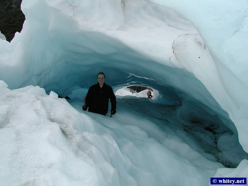 Fox Glacier, South Island, New Zealand – Andrew inside an ice cave.